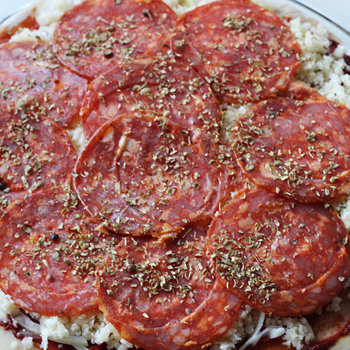 5. Sliced pepperoni and dried oregano.