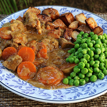 With roast potatoes (beef dripping) and peas.