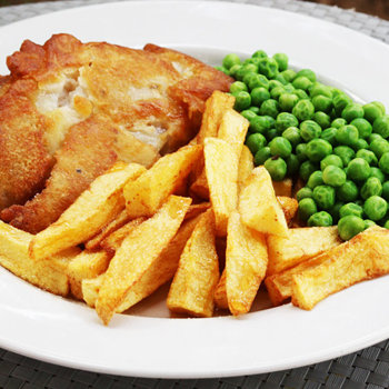 Battered pollock, chips and peas.