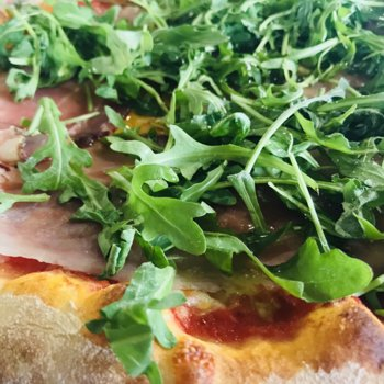 Pizza with rocket salad and speck ham.jpeg