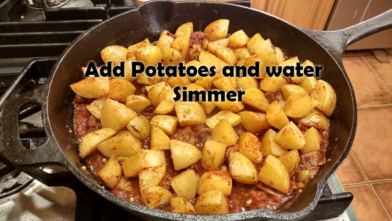 Spanish-potatoes-05-Add-potatoes-and-water-simmer.jpg